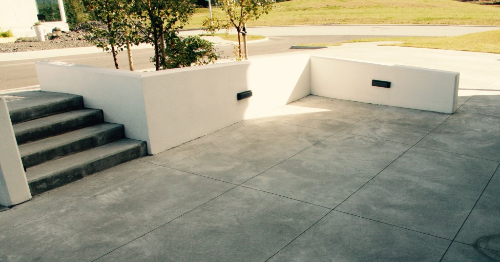 White retaining walls and cut concrete