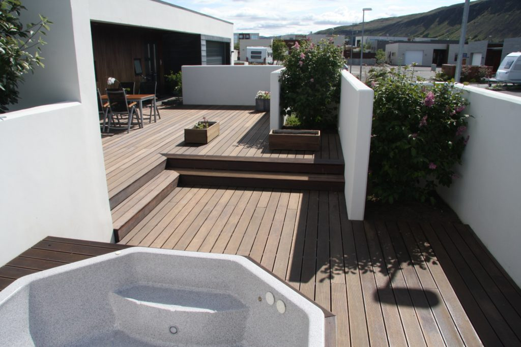 Functional house and decking surrounded by white walls